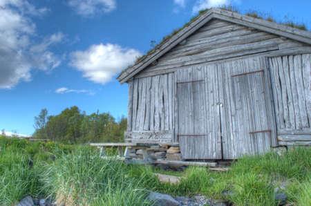 boathouse: old beautiful weathered boathouse near ocean