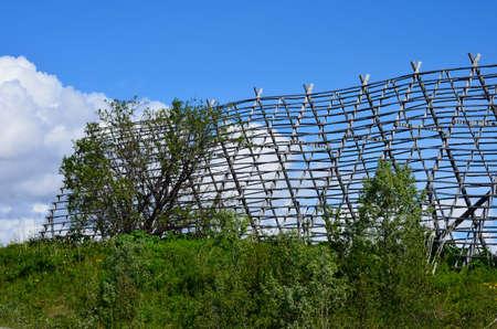 stockfish: wooden stockfish structure on blue summer sky
