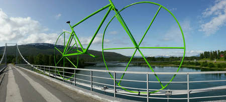 metal: Huge green metal bicycle on bridge, arctic race of Norway bicycle race