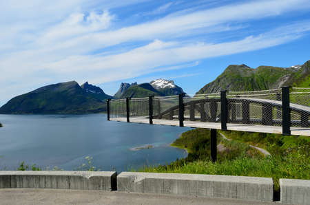 lookout point bridge with mountain and fjord landscape island of senja arctic circle