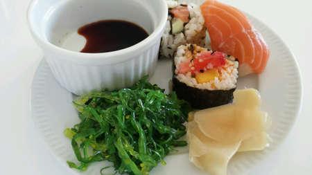 soysauce: Sushi platter on white  Stock Photo