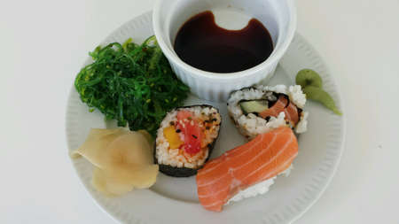 soysauce: Sushi platter on white overview photo Stock Photo