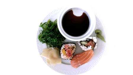 black white red: Sushi platter on white overview photo Stock Photo