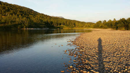 refelction: Maalselv river with salmon fishermen