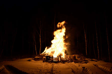 winter night: massive wood fire in winter night Stock Photo