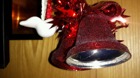 shiny: Christmas bell with bowtie on wall Stock Photo