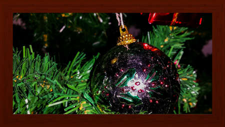 decor: Shiny christmas ball decor on christmas tree