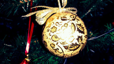 decor: Golden christmas decor on tree Stock Photo