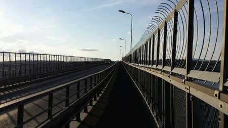 fence: Long walkway on bridge Stock Photo
