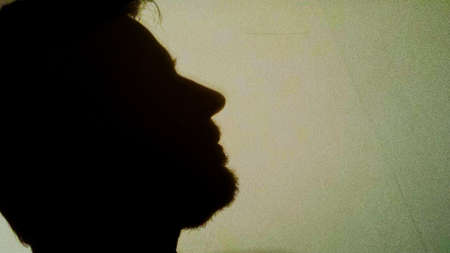 nose: Human male head with beard silhouette on wall
