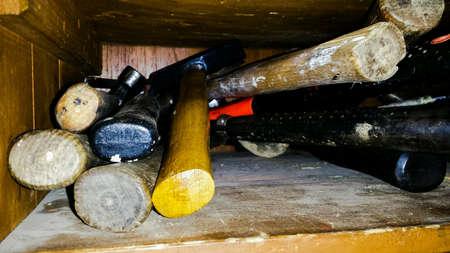 metal: Hammer tools in wooden shop shelf