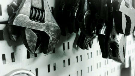 metal: Different sized metal wrenches on tool wall