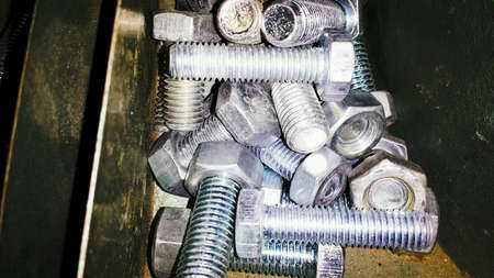 shiny metal: Metal bolts in storage shelf