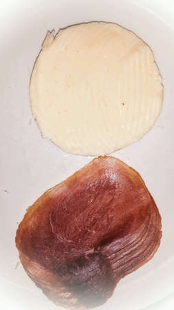 white: Combed cheese and ham snack on white plate Stock Photo