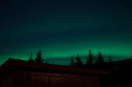 borealis: aurora borealis over red garage and forest