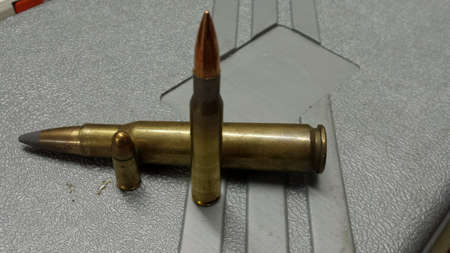 cal: Different sized ammunition on plastic case