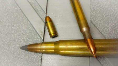 9mm ammo: Different sized ammunition flat on plastic case macro photo Stock Photo