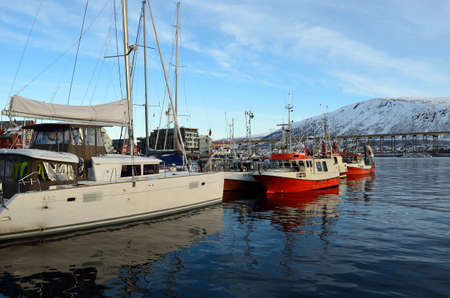 docket: different boats docket in tromsoe city harbour on a sunny blue day 20th february 2016