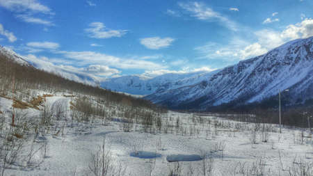 excersise: Wonderful mountain valley landscape in snowy winter wonderland with cross country skiing trail Stock Photo
