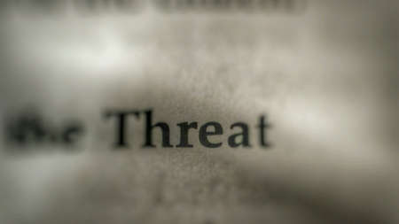 threat: Threat text on paper