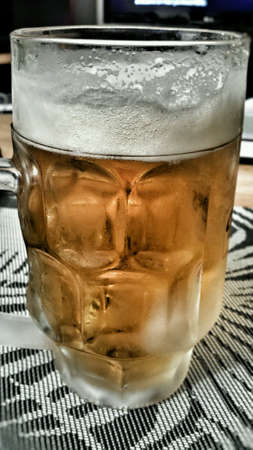 near beer: Ice cold refrigirated beer in glass with dew drops on glass side Stock Photo