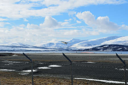 attempts: TROMSOE, NORWAY - APRIL 17, 2016: small school plane attempts to land on Langnes airport Editorial