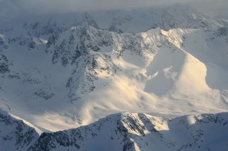 an overview: majestic snowy mountain in northern norway aerial overview