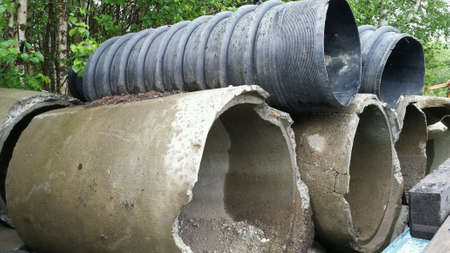 drainage: Massive concrete and plastic drainage pipes stacked