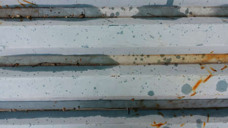 metal: Blue and rusted corrigated metal plate background texture