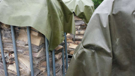 metal: Firewood logs stacked in sack and metal cases background