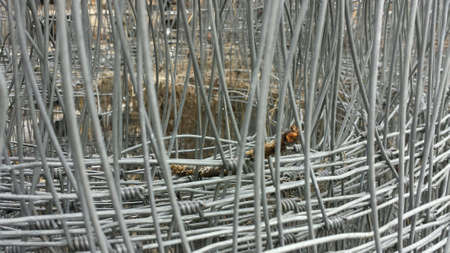 wire: Metal fence rolled into a pile background texture Stock Photo