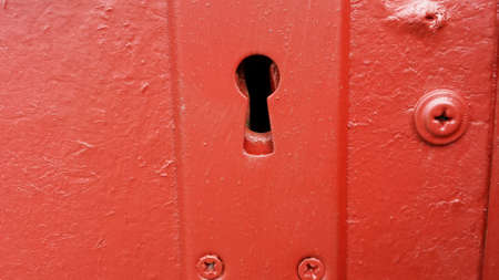 detail: Red door keyhole Stock Photo