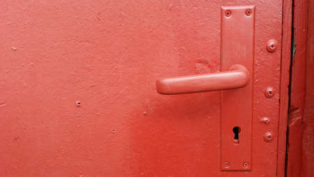 door handle: Red door, handle and keyhole Stock Photo
