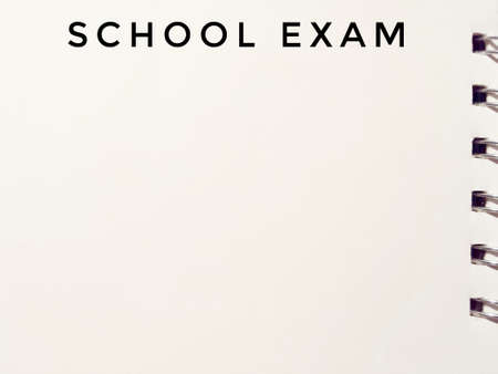 school exam written on white paper notepad Stock Photo
