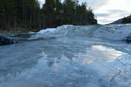 buildup: cold frozen mountain creek with ice buildup Stock Photo
