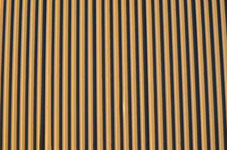 corrugation: light brown corrigated steel plate building wall background