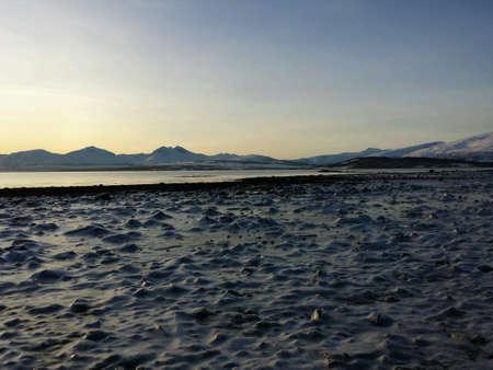 detail: Frozen seashore and mountain range in the arctic circle Stock Photo