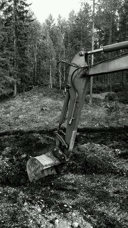 Excavator arm digging in mud vintage frame Stock Photo