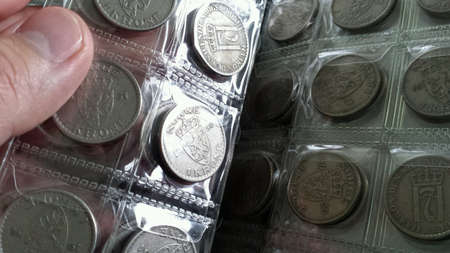 Turning pages in coin book with old norwegian coins Zdjęcie Seryjne