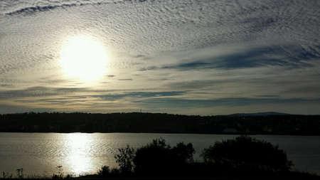 Dawn sun over tromsoe city island with fjord reflection Zdjęcie Seryjne