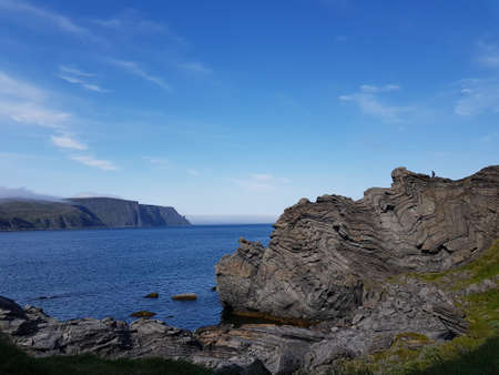 Majestic ocean and mountain view in Skarsvaag on the Mageroy island north cape county 免版税图像