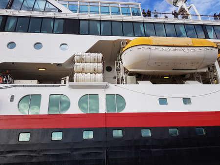 HONNINGSVAAG, NORWAY - JUNE 26 2018: The norwegian coastal express hurtigruten docked at honningsvaag harbor