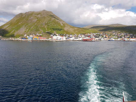 honningsvaag city in northcape county seen from the ocean on a blue sunny day