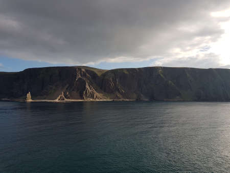 majestic mountain formation with blue sky and sea in northern norway in the sail in to Kjollefjord 写真素材