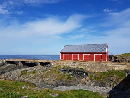 BERLEVAAG, NORWAY JULY 27 2018: Berlevaag lighthouse and watchmen buildings in summer Editorial