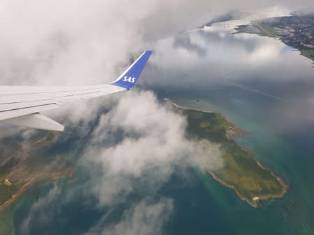 TROMSO, NORWAY AUGUST 19 2018: sas airplane with tromsoe city in the background Editorial
