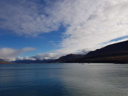 blue sea and mountain view with longyear city in the fjord on svalbard island Stock Photo