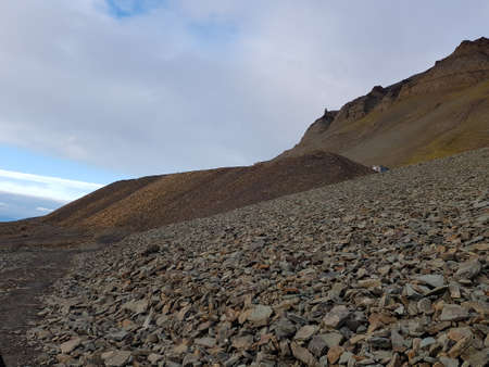massive mountain with loose rock slide stone on svalbard, bear valley