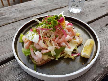 fresh norwegian prawn sandwich with greens and lemon