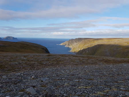 majestic barren landscape with blue sea on the mageroy island in Finnmark